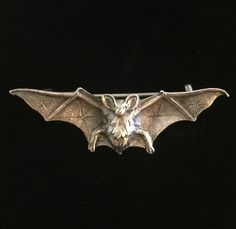 Antique bat brooch