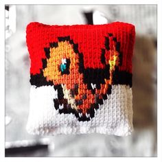 Now available on the #cannon_ink etsy shop.  https://www.etsy.com/shop/CannonInk?ref=hdr_shop_menu #Charmander #Charmeleon #Pokemon #Pokeball #crochet #pillow #pixel #pixelart #knitpillow