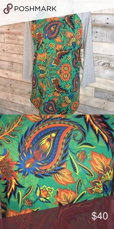 NWT L Lularoe Randy NWT L Lularoe Randy. Gray sleeves with Green body. Blue, red, orange and yellow detail LuLaRoe Tops