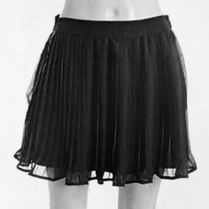 """BCBG Chiffon Black Pleated Skirt 10/9 HP Everyday Essential by @sheokay   Black chiffon knife pleated short skirt. Fully lined. Half inch elastic waistband.  100% poly Machine washable  16"""" overall length EUC  Put on this skirt, add heels and WOW!!! BCBGeneration Skirts"""