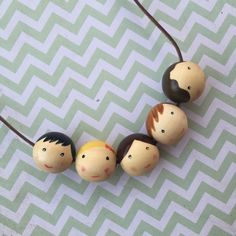 Wooden bead necklace / Family beads necklace / doll face beads / painted face/ wooden peg people faces / personalised to your family by OneOfAHandmadeKind on Etsy https://www.etsy.com/listing/239779953/wooden-bead-necklace-family-beads