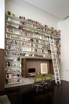 Awesome bookshelf wall PLUS Herman Miller Eames designed Group Chairs.  awesome.  edit: on closer inspection I think those are knock offs.  please correct me if you know better than I.