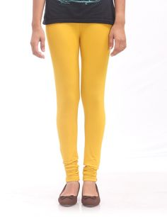 The golden color from the shelter of prisma leggings brings the brightness to your personality. The elastic nature of fabric creates the stress free sense.