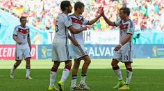 Thomas Mueller of Germany (2nd R) celebrates with teammates Sami Khedira (2nd L) and Mario Goetze (R)