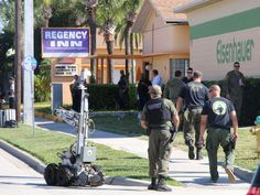 A man wanted in the killing of his father in St. Johns County was found dead along with a woman on Thursday morning in a Daytona Beach motel, following a standoff that closed part of North Ridgewood Avenue.  #murder #daytonabeach #josephreddock