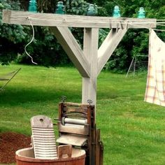 old style lines with insulators for clothesline ~ I will have a clothes line again some day!