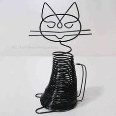 A classic Art Deco Retro vintage wire sculpture of a black cat.    The cat holds letters or business cards and a pen. NOS = New Old Stock = NEW These are metal
