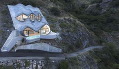 The House on the Cliff  / GilBartolome Architects