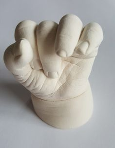 A cast of your baby's hand is a stunning keepsake or gift. Available at: https://babyprintsandcastings.co.uk/product/framed-baby-cast-single-hand-foot/