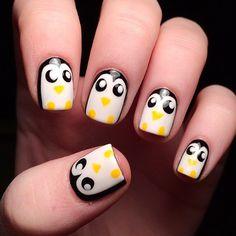 Christmas nail art ideas // Penguin festive nail designs. Simon Jersey supplies beauty tunics for beauty salons, spas and more. Shop beauty uniforms at www.simonjersey.com #christmas #festive #penguin #nails #nailart #beauty #tunic #beautyuniform