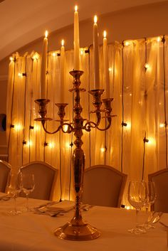 Brass table candelabra and rustic lace backdrop with festoon cascade overlay by www.stressfreehire.com #venuetransformers