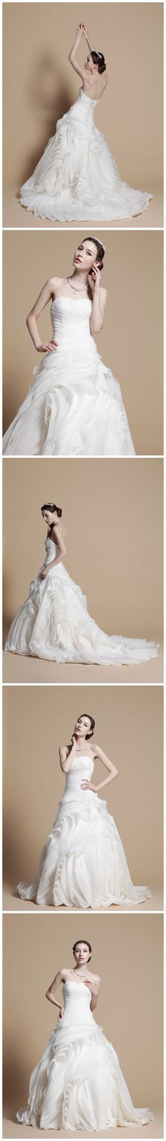 Good wedding dress website... this dress is funky. Not what I'm aiming for but yeah the website is good.