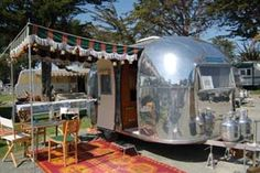 """Old Trailers. Com """"Vintage travel trailer resources, info about campouts and clubs to join, and a huge pile of pictures of vintage trailers to distract you and keep you from doing any real work!"""" True!"""