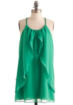 Beach Party:  With those gorgeous ruffles, it's like you stepped straight from the waves, a goddess in green from lost Atlantis.  The easy fit is perfect for a lazy day on the beach.  Pair this with some jeweled sandals and, of course, your sleekest suit.