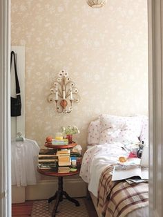Rita Konig's West Village apartment. Wallpapered bedroom, D. Porthault linens, heart pattern, small bedroom, NYC apartment