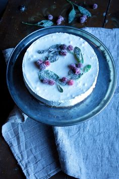 white chocolate truffle cheesecake with gingerbread crust and sugared decorations