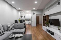 Sala de estar, jantar e cozinha integradas no cinza