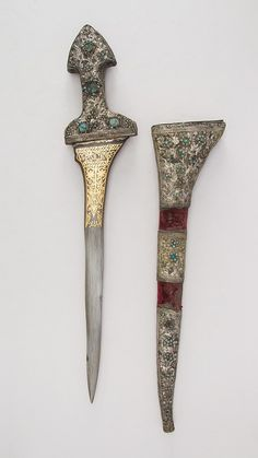 Kris with Sheath Date: Blade, 1766–67; Mount, 19th century Geography: Malay Culture: Malayan with Turkish mountings Medium: Steel, wood, silver, turquoise, garnet