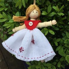 A new and limited edition Spoolie Doll. This one celebrates my most  favourite thing - redwork!You can make her on her own to add her to your  Spoolie Doll collection. It's dead easy to make from miniature cotton  reels, buttons, beads and a wee bit of stitching. These kits are hugely  popular