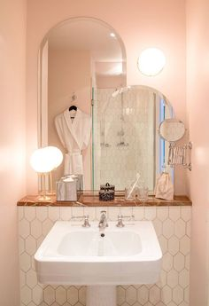Powder Room: 11 Favorite Pink-Hued Bathrooms, Modern Edition - Remodelista - Cotton-candy-colored walls are matched with deep pink marble in a guest bath at Hotel des Grands Bo - Modern Bathroom Tile, Bathroom Interior, Interior Paint, Feminine Bathroom, Interior Design, Rental Bathroom, Natural Bathroom, Bathroom Marble, Beige Bathroom