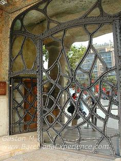 Two huge glass doors laced in iron invite us to enter Antoni Gaudi's world. You will have a hard time finding any right angles.