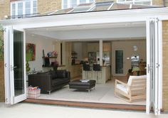 I want these doors for my living room to my patio! 009 Folding Sliding Doors and Orangery extension on modern house, Clapham Common, London Orangerie Extension, Conservatory Extension, Orangery Extension Kitchen, Rear Extension, Extension Ideas, Extension Google, Glass Extension, Conservatory Kitchen, Kitchen Orangery