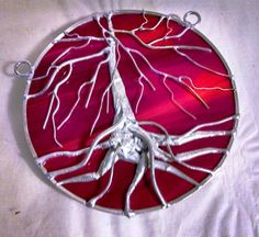 strangely enough, there is no size given on this item? is it a necklace? or  a window suncatcher?  Stained Glass Tree of Life Red Orange Small Double by Glassquirks, $75.00