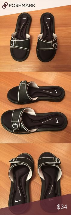 NWB Nike Comfort Slides NWB Nike comfort slides for women. Black comfort slide with white Nike etching. Fits true to size. Extremely comfortable and great grip at bottom. Nike Shoes