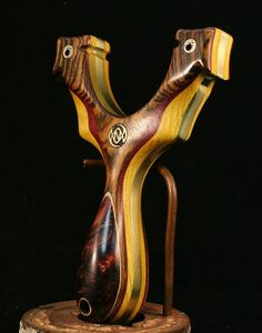 A second custom slingshot, this one by Nathan Masters owner of Simple Shots Slingshots. Again exotic timbers with metal core; and again largely Rosewood....