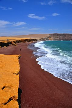 Red sand coast in the Paracas Peninsula National Reserve in Peru