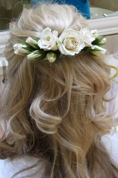 Ivory  rose buds in hair. Use floral wire to wire spray rose flower buds onto a hair comb or piece of floral wire that will be bobby pinned into hair.