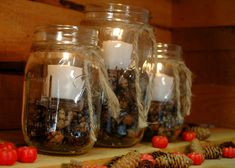 Rustic set of 3 Mason Jars filled with Pinecones and candle for table decor, holiday decor, rustic decor on Etsy, $28.00