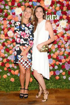 Natalie Joos and Zani Gugelmann looked lovely against Max Mara's floral backdrop in New York. Wearing Nina Clutch