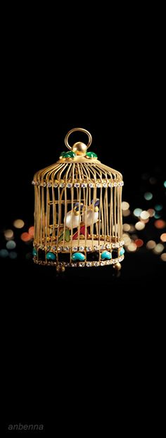Chanel Gold Christmas Bird Cage. The cage is two pocket-sized life-like bird of paradise, emerald pearl and white bird of paradise cleverly formed the eyes and body, they cling to each other on the perch, the bird beak contrast, seem to have lots to talk about intimate topics …