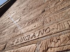 Ancient Roman graffiti inscribed on the Colosseum.