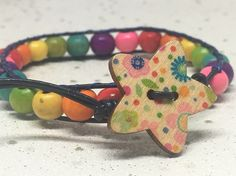 Rainbow bead and navy leather bracelet Wooden Stars, Wrap Bracelets, Organza Gift Bags, Silver Stars, Star Shape, Leather Cord, Rainbow Colors, Navy, Beads