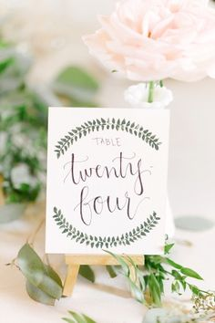 Pretty rustic table signs: http://www.stylemepretty.com/ohio-weddings/columbus/2015/09/30/romantic-outdoor-bohemian-woodland-wedding/   Photography: Leigh Elizabeth - http://www.leighelizabeth.com/