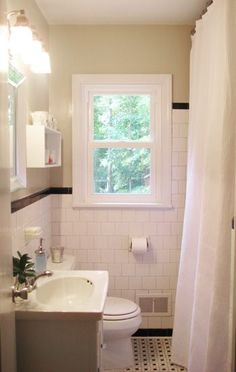 Like the idea of hanging a shower curtain higher than necessary....like curtains. Makes the ceilings look higher.
