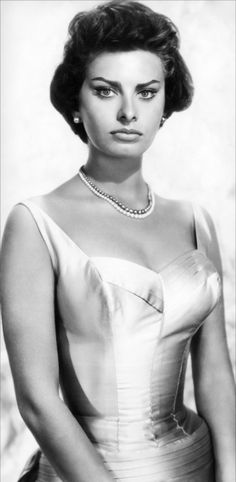 "Sophia Loren | ""A woman's dress should be like a barbed-wire fence: serving its purpose without obstructing the view."""