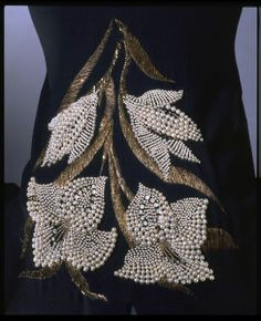 Elsa Schiaparelli Haute Couture evening dress, A bold embroidered spray of lilies by the House of Lesage. Pearl Embroidery, Tambour Embroidery, Couture Embroidery, Embroidery Patterns, Hand Embroidery, Couture Details, Fashion Details, Tambour Beading, Motifs Perler