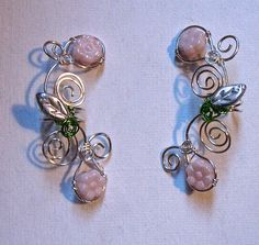 This listing is for a pair (2) of ear cuffs with silver swirls accented with Czech glass pink flowers and silver coated leaves.
