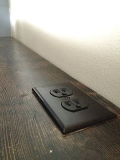 outlet on narrow shelf behind couch?, (also add a cut-out + basket in the middle a la YHL?)