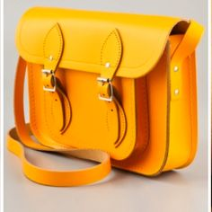 Cambridge Satchel. Something like this would be SUPER cute with a cuff sleeve Navy Blazer and some Blue Jeans and matching flats.