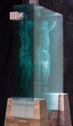 """The Hidden Face Of God, a """"Windows Into Souls"""" glass sculpture by Jed Malitz. Photographed by Chip Kennedy"""