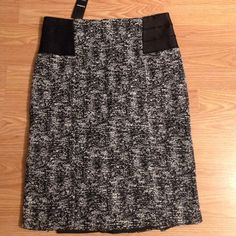 Bebe black and white designed skirt NWT! Very stretchy material elastic black material around top on sides zippers down in back bebe Skirts Pencil