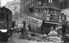 Hauling tackle is being attached to the top of a 77 bus which fell into a bomb crater in a London street, one of the previously unseen photographs from the British Censorship Library collection issued to mark the anniversary of the Blitz. London Bus, London Street, Blitz London, Vintage London, Old London, London Bombings, London Summer, The Blitz, London History