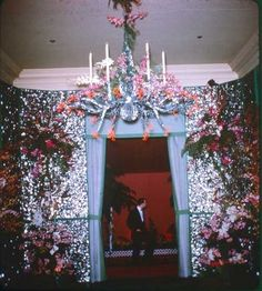 Walls of crushed Abalone shell and a Tony Duquette Nacre and Coral Chandelier serve as decorations at Mrs. William Roth's Undersea Ball.