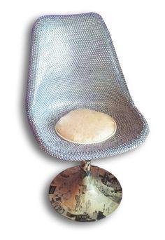 """""""Bulletta"""" La nuova sedia anni '60 interamente rivestita di bulloni, vecchi giornali anni '50 originali e un cuscino in cellophane con dentro pura lana vergine di pecora......tutta realizzata con materiali riciclati!"""