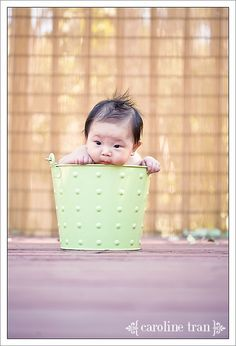 i wonder when someone had the thought to stick a baby in a metal bucket....