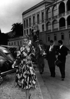 Grace Kelly just before her first meeting with Prince Rainier in the palace of Monaco, 1955.